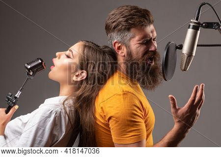 Couple Singing. Singer Friends Singing Rock. Sound Producer Recording Song In A Music Studio. Excite