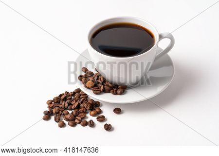 Black Coffee In A White Cup And Coffee Beans Isolated On White Background, Copy Space For Text,top V