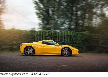 Kyiv, Ukraine - August 2020. Yellow Italian Supercar Ferrari 458 Spider In The Motion.