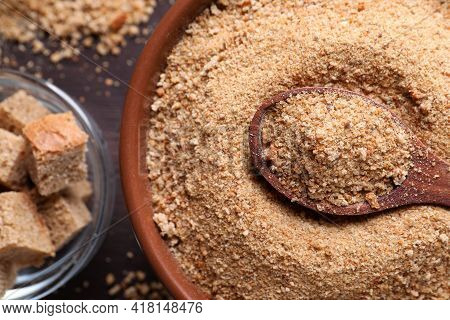 Fresh Breadcrumbs And Spoon On Wooden Table, Flat Lay