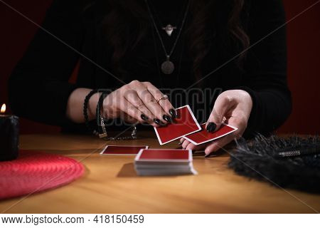 Soothsayer Predicting Future With Cards At Table Indoors, Closeup