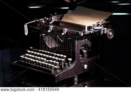 Vintage Mechanical Typewriter With Cyrillic Keyboard Layout With Installed Paper Sheet On Black Back