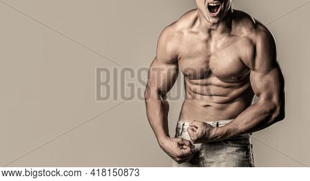 Muscular Man Screaming. Screaming Man With Well Trained Body, Biceps, Abs And Pecs And Wearing. Musc