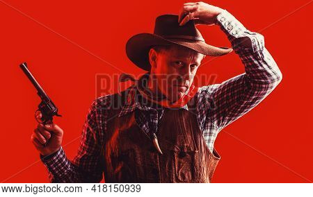 Portrait Of Man Wearing Cowboy Hat, Gun. Portrait Of A Cowboy. West, Guns. Portrait Of A Cowboy. Wes