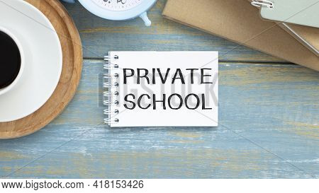 Private School, A Golden With Grad Cap Piggy Bank, Card And Calculator On A Wood Background With Tex