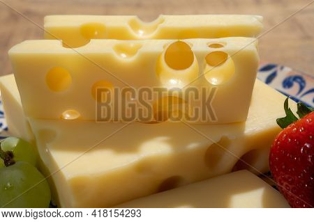 Cheese Collection, Blocks Of French Emmentaler Cheese With Many Round Holes Made From Cow Milk Close