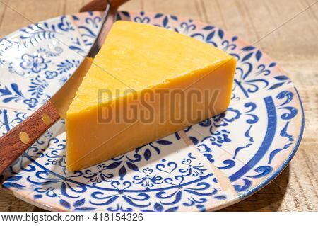 Cheese Collection, Piece Of British Yellow Cheddar Cheese Made In Somerset From Cow Milk