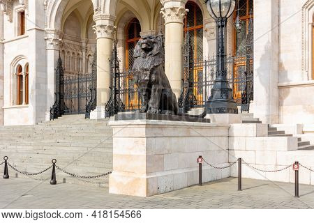 Lion Statue At Hungarian Parliament Entrance In Budapest