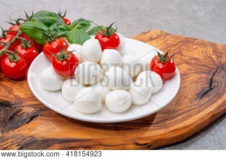 Italian Tricolore, Small Balls Of Fresh White Soft Italian Mozzarella Cheese, Ripe Red Cherry Tomato