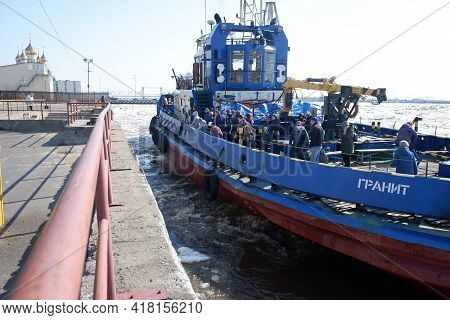 Arkhangelsk Russia, 04-23-2021. The Tug Transports People From The Islands To The Mainland Along The