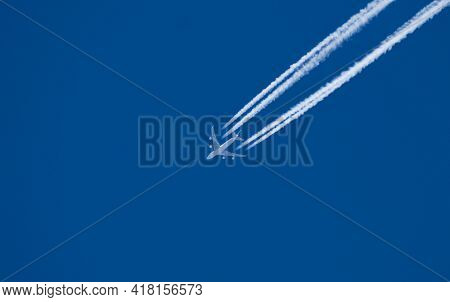 Passenger Plane Flying At High Altitude. Blue Sky. Travel, Vacation - Concept