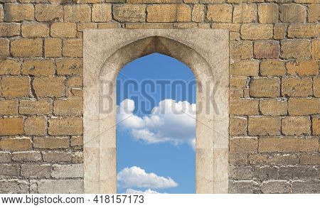 Blue Sky With Clouds Seen Through Ancient Portal Gateway In Old Stone Wall