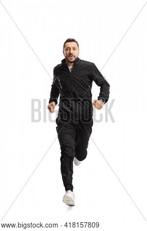 Full length portrait of a man in black tracksuits running isolated on white background