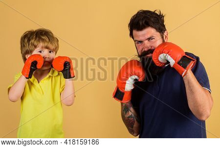 Child Sportsman At Boxing Training With Coach. Ready For Sparring. Bearded Sports Man Coaching Boxin