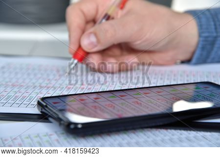 Businessman Adjusts Business Statistic. Internet Trading And Stock Statistics Concept. Close Up