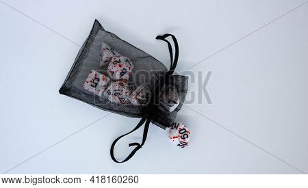 Black Transparent Pouch And Dice Isolated On White Background.flying Dice.