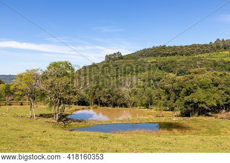 Farm Fields, Lakes, Forest And Mountains