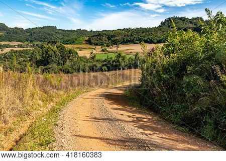 Dirty Road With Farm Fields, Forest And Mountains, Santa Maria Do Herval, Rio Grande Do Sul, Brazil