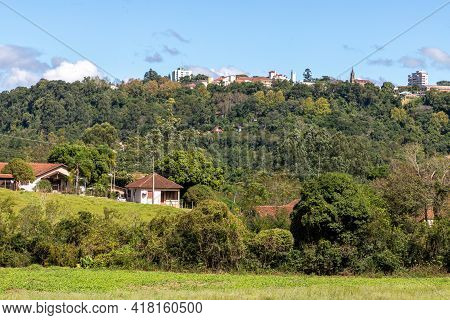 Farm Field, Forest And Village Over Mountain