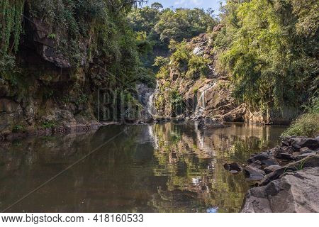 Sao Miguel Waterfall With Rocks, Trees And Plants