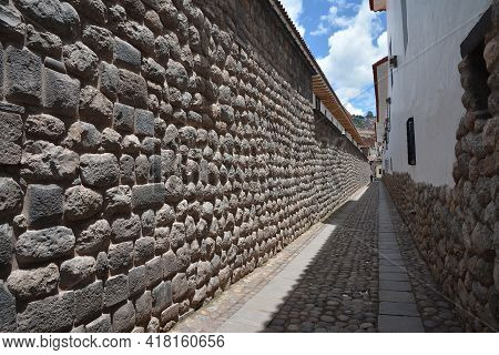 Old Inka Wall In City Of Cuzco In Peru, South America.\nhorizontal View.