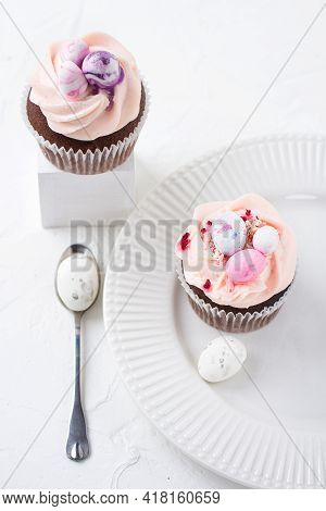 Two Easter Chocolate Cupcakes With Caramel Filling And Decoration Of Small Easter Eggs From Marzipan