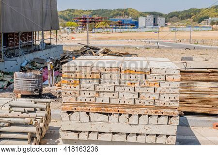 Daejeon, South Korea; April 18, 2021: Metal Forms Used In Concrete Work Stacked Neatly At Constructi