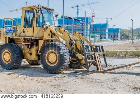 Daejeon, South Korea; April 18, 2021: Large Industrial Forklift Parked At Construction Site With New