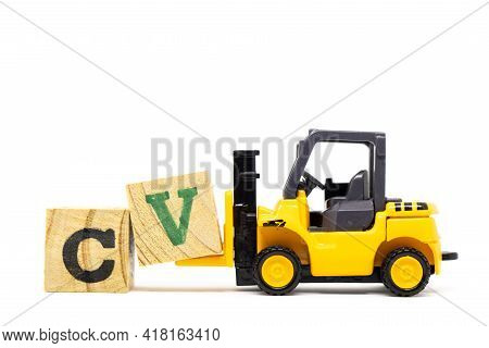 Toy Forklift Hold Letter Block V To Complete Word Cv (abbreviation Of Curriculum Vitae) On Wood Back