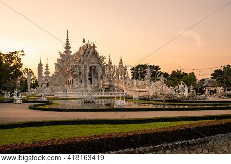 Beautiful View Of White Temple (wat Rong Khun) In Chiang Rai Province Of Thailand At Sunset. The Wat