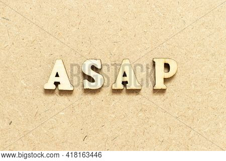 Alphabet Letter In Word Asap (abbreviation Of As Soon As Possible) On Wood Background