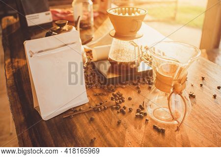 Zipper Bag Coffee With Coffee Beans And Scales On Wooden Table. Prepare Coffee Making On The Morning