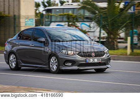 Alanya, Turkey - April 12 2021: Silver Fiat Albea Is Driving Fast On The Street On A Warm Summer Day