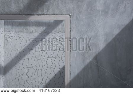 Sunlight And Shadow On Surface Of Door Frame In Concrete Wall Inside Of Incomplete House Constructio