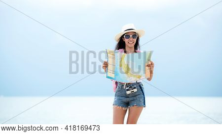 Happy Traveler And Tourism Young Women Travel Summer On The Beach. Asian Smiling People Holding Map