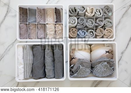 Womans Underwear, Pajamas And Socks Neatly Folded And Placed In Closet Organizer Drawer Divider On W