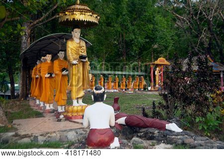 Ranong , Thailand - April 4 , 2021 : Statues Of Monks Walking Alms In Rows Of Burmese Arts But Enshr