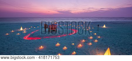 Romantic Dinner With Candles Lamps At Ocean Beach During Wonderful Sunset Sky And Flying Birds Coupl
