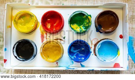 Top View Of The Bright Colorful Paints In Paper Box With Soft Effect, Close Up