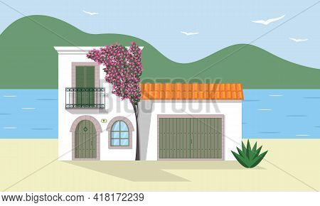 Typical White Mediterranean House With Garage And Bougainvillea Tree In Blossom On Seashore. Costal