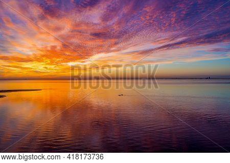 Kayaking On Mobile Bay, Alabama At Sunset