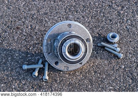 Engine Gears. Auto Motor Mechanic Spare Or Automotive Piece On Dark Road Asphalt Background. Tarmac