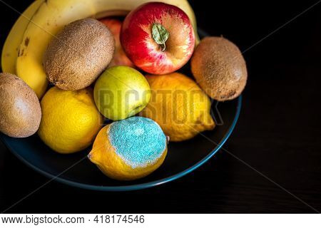 Ripe Colorful Whole Fruits: Green And Red Apples, Kiwi, Yellow Lemons, Bananas In A Plate With Spoil