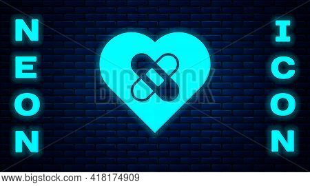 Glowing Neon Healed Broken Heart Or Divorce Icon Isolated On Brick Wall Background. Shattered And Pa