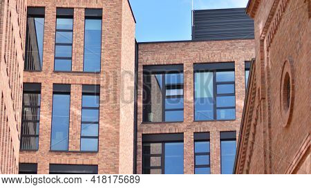 Modern Brick And Glass Facade Of The Office Building.  A Contrasting Combination Of Sky And Brick Te