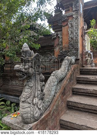 Denpasar, Indonesia - October 18, 2019 : Balinese Snake Statue On The Handrail Of A Gate At Bali Mus