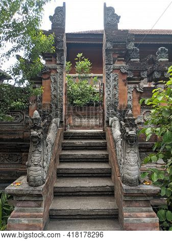 Denpasar, Indonesia - October 18, 2019 : Balinese Snake Statues On The Handrail Of A Gate At Bali Mu