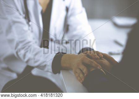 Unknown Woman-doctor Is Reassuring Her Female Patient, Close-up. Physician Is Consulting And Giving