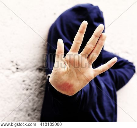 Open Hand Of Young Girl Trying To Protect Herself From Violence With Very Dramatic Photographic Effe