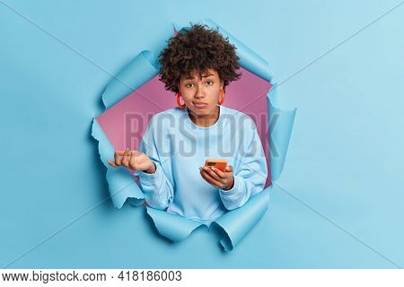 Hesitant Unaware Afro American Woman Doesnt Know Why Her Phone Isnt Working Cannot Solve Problem Wit